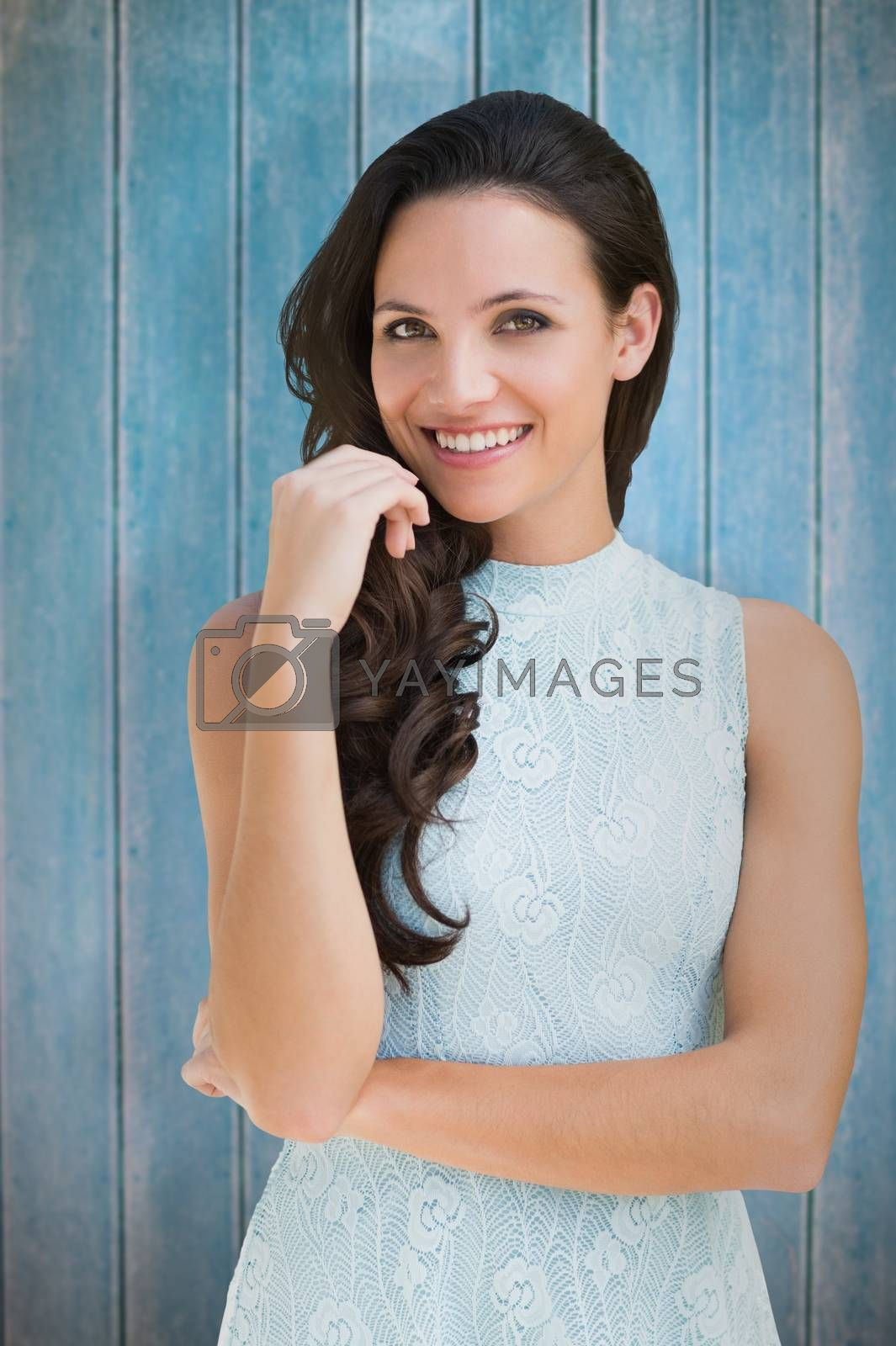 Stylish brunette against wooden planks