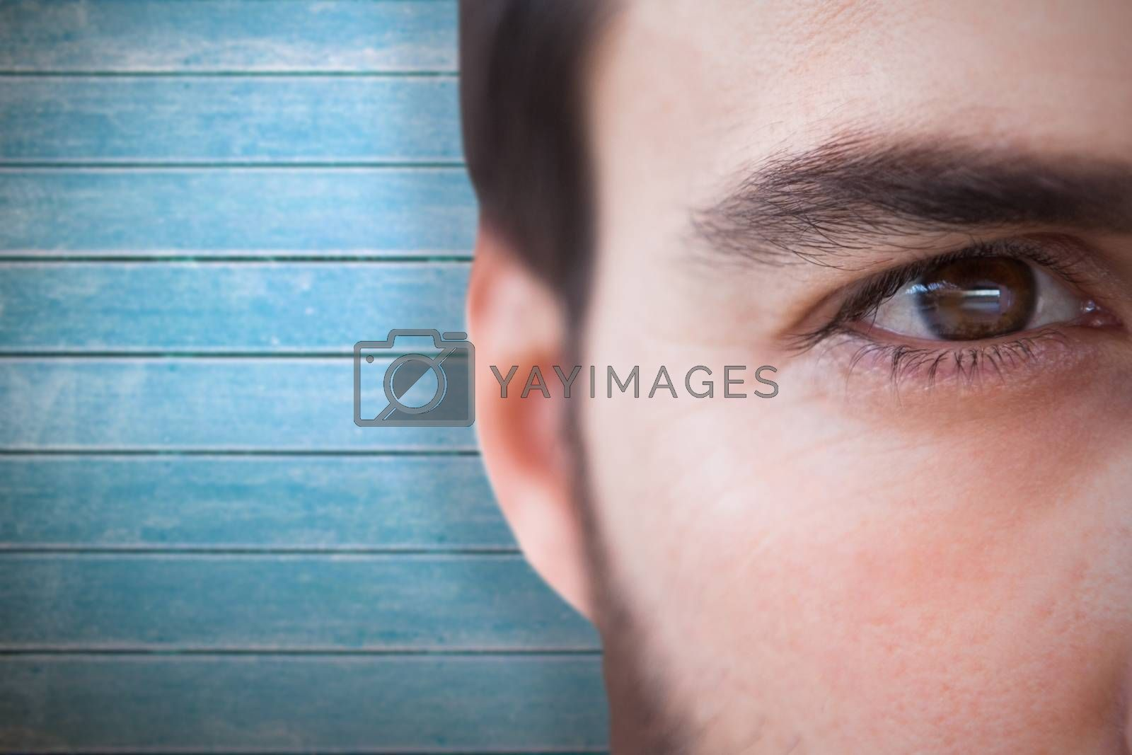 Close up of focused businessman against wooden planks