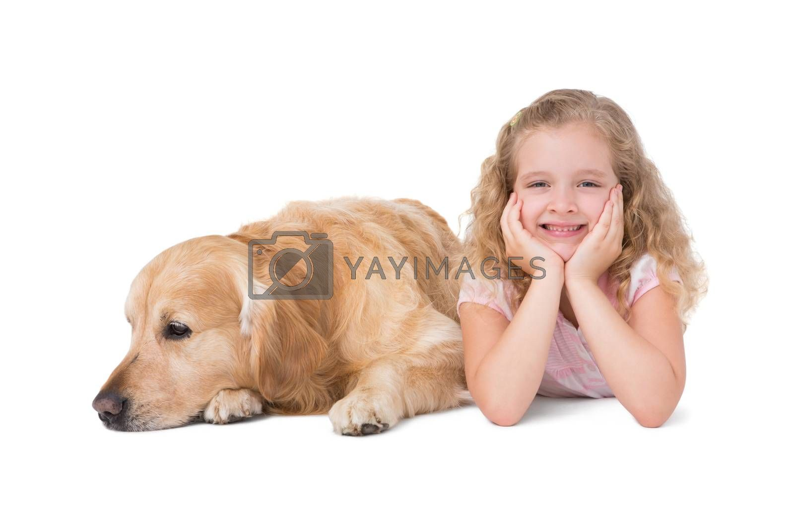 Little girl and dog lying on the floor on white background