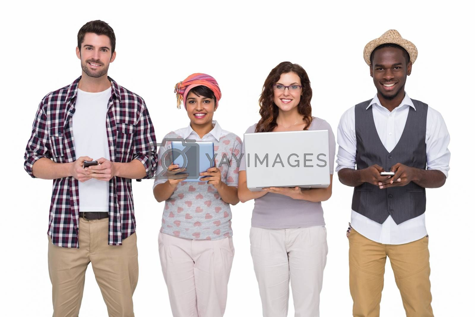 Smiling coworkers with technology posing on white background