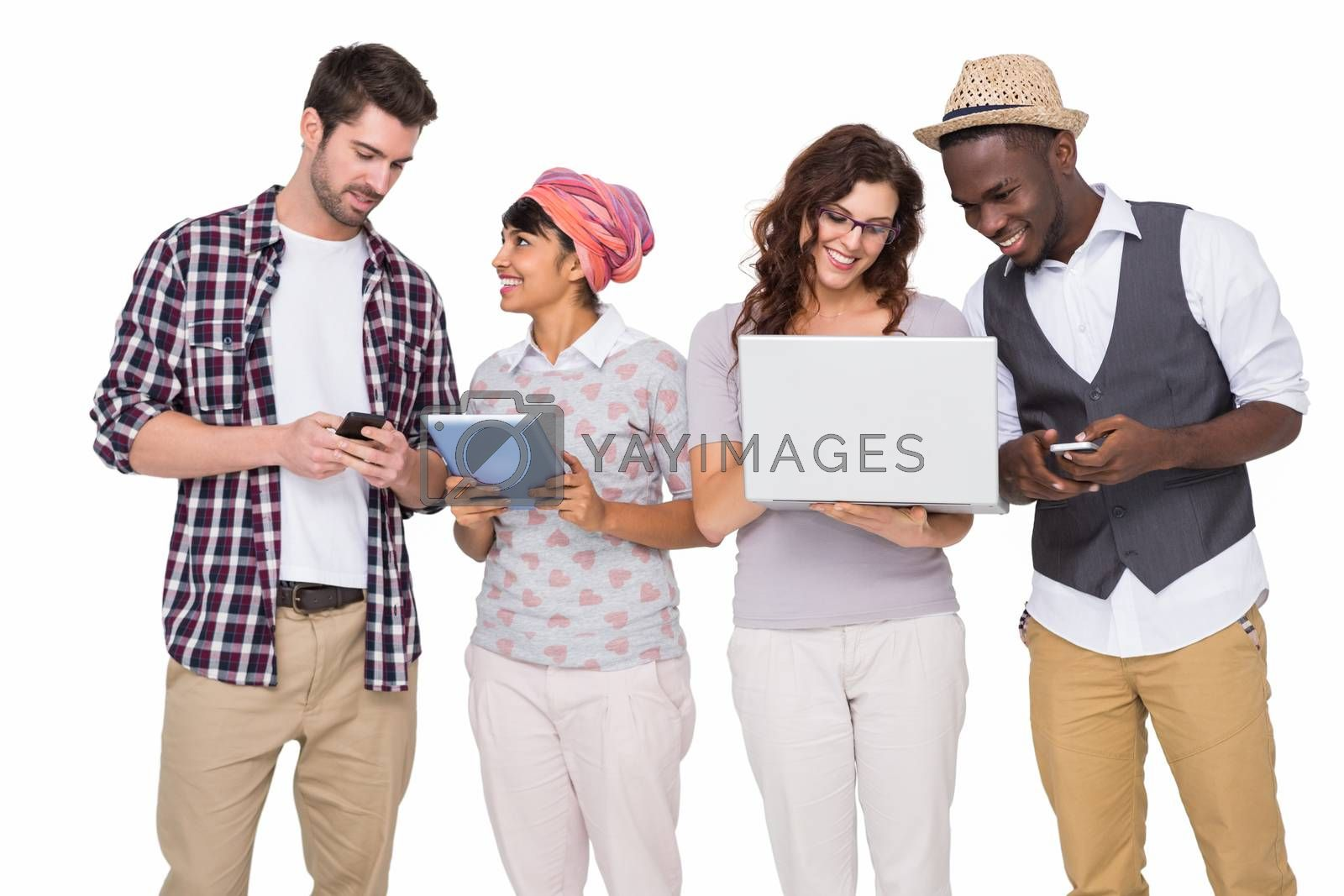 Smiling coworkers with technology interacting together on white background