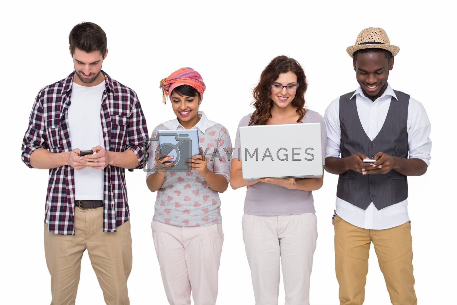 Smiling coworkers standing and using technology on white background