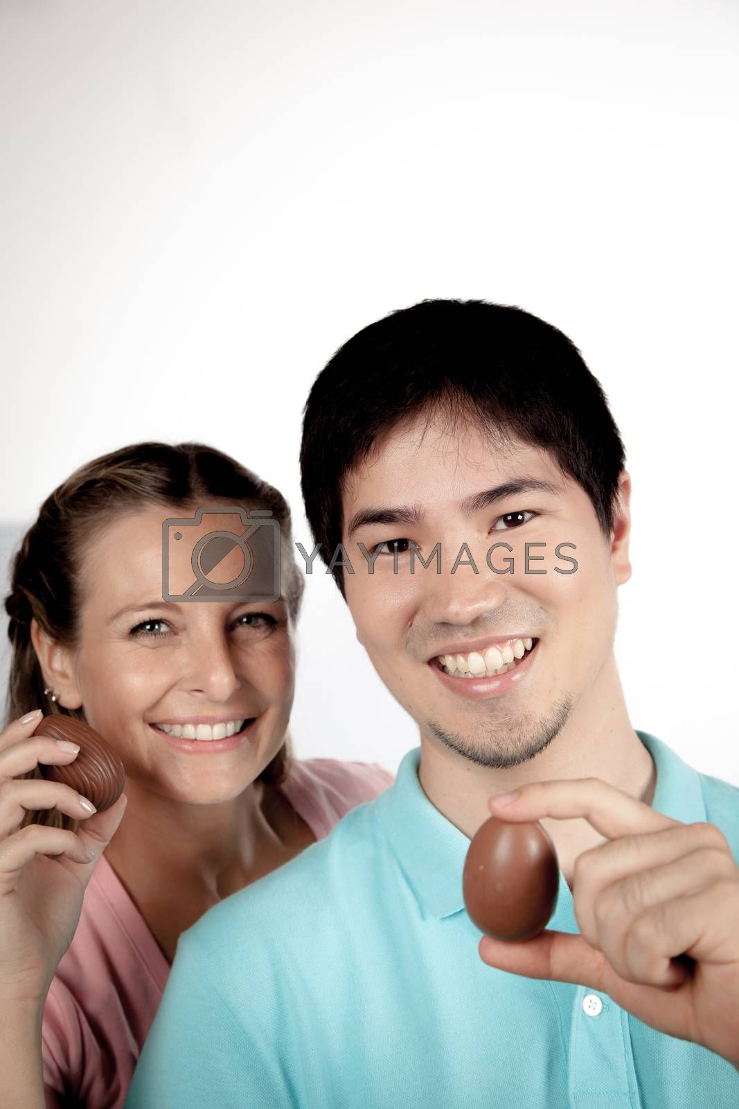 20-25, asian, background, caucasian, Couple, covering, decoration, easter, egg, event, felicity, female, giving, hand, handmade, happy, holding, hope, human, life, love, man, model, old, one, palm, people, person, portrait, property, releases, seasonal, show, showing, smile, smiling, studio, surprise, symbol, together, traditional, white, woman, years, young