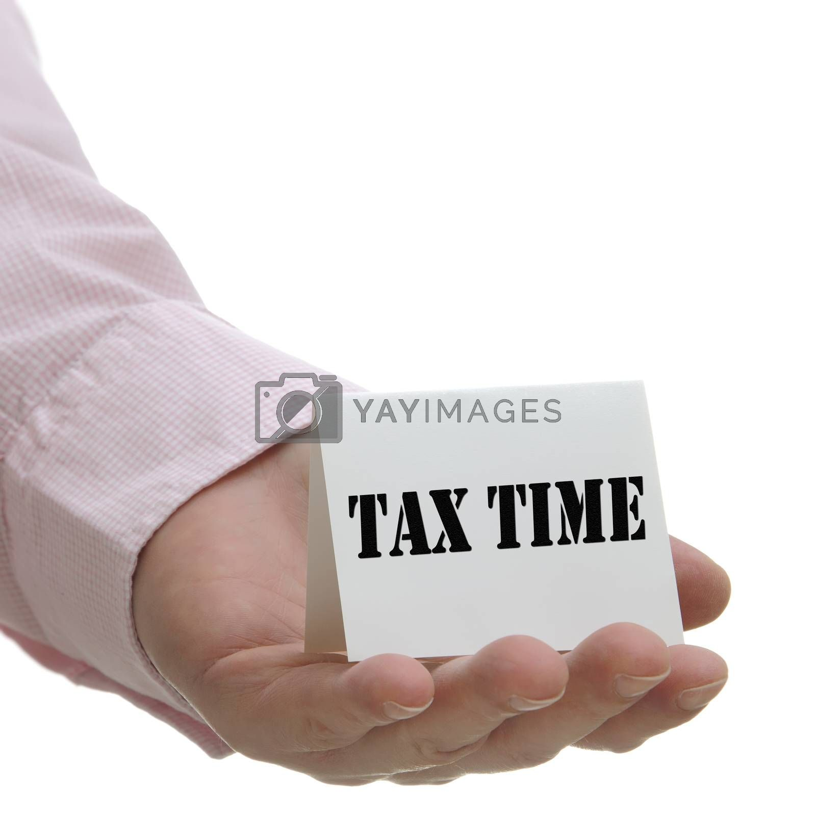 Business man holding tax time sign on hand