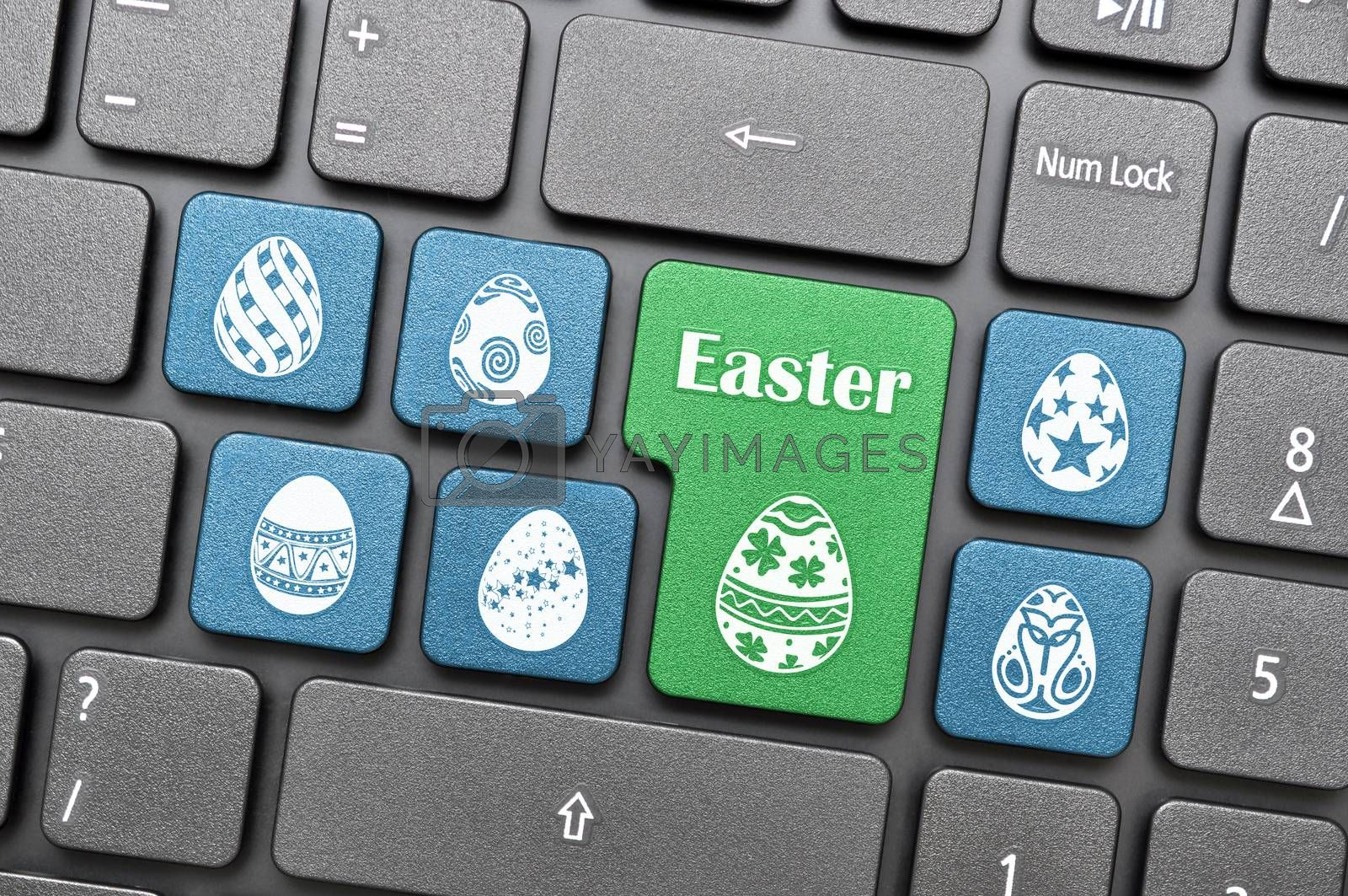 Blue and green easter egg on keyboard