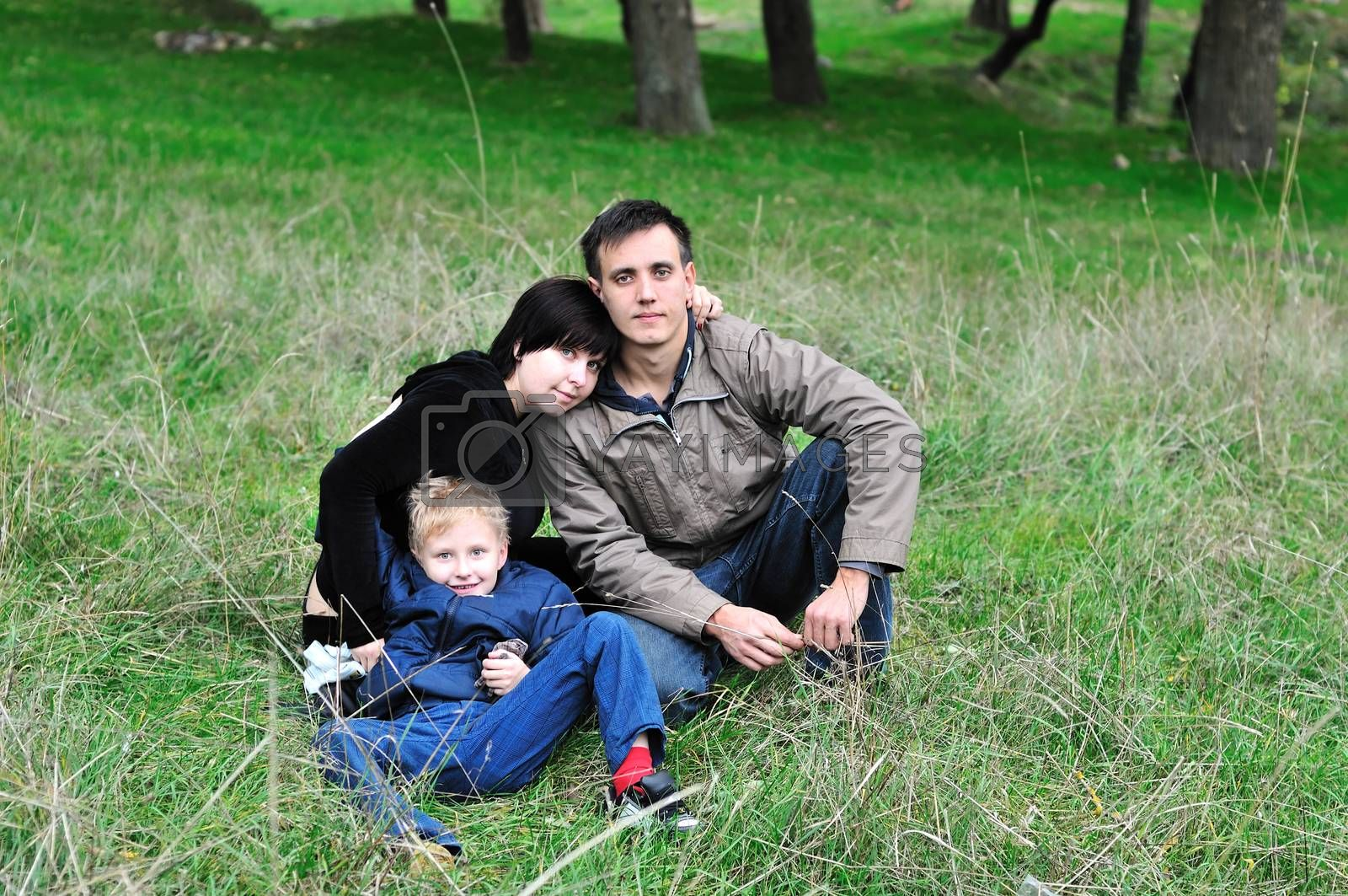 happy loving family in the forest during early autumn