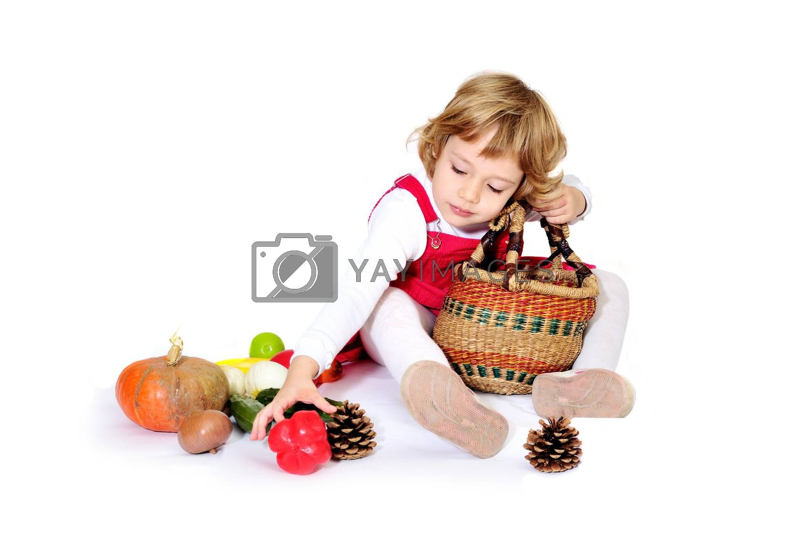 girl playing with vegetables, she gathering harvest