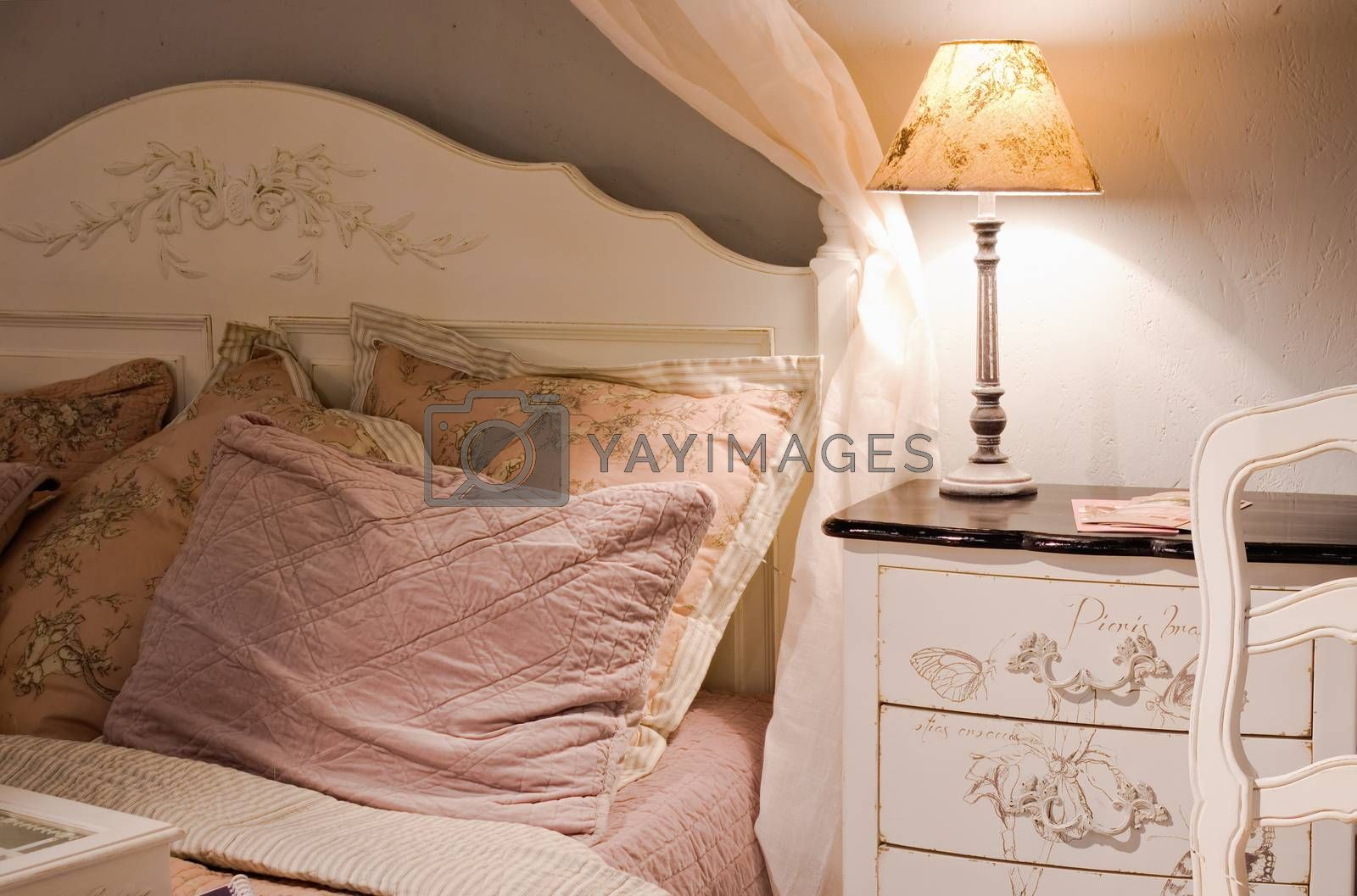 luxury bedroom with lamp on table