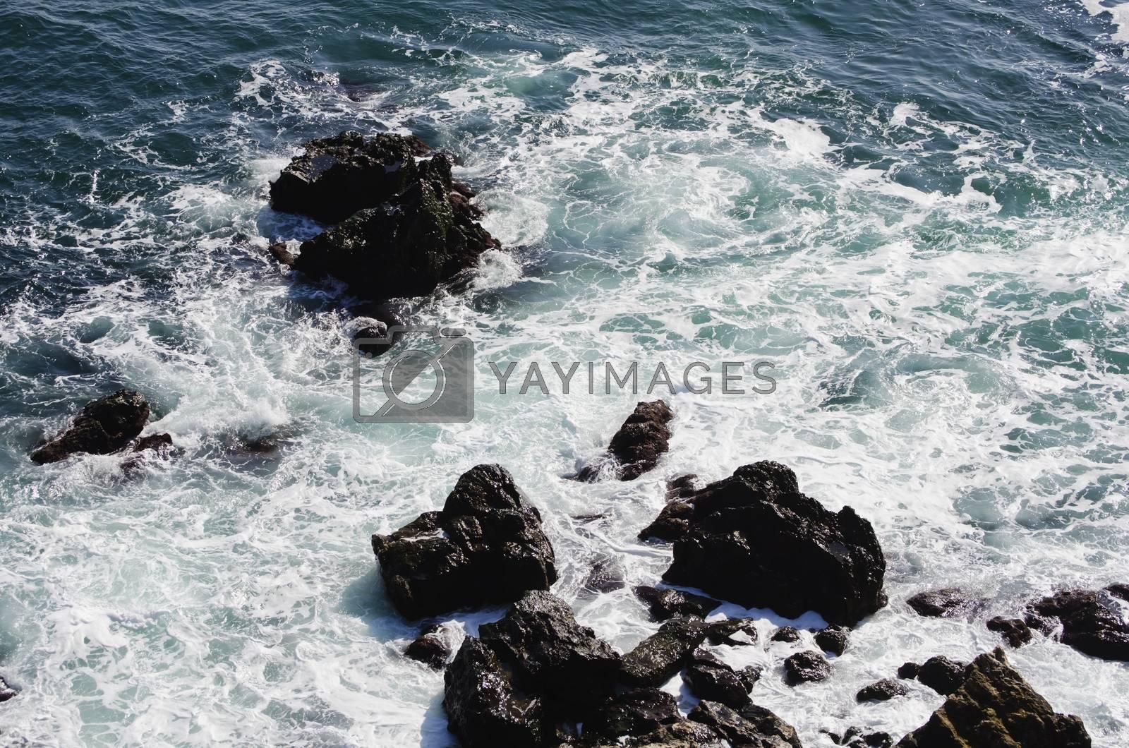 Wavy Black Sea With Stones