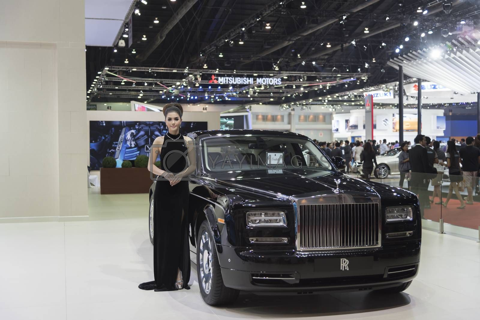 BANGKOK,THAILAND - APRIL 4 :New Classical car brand Rolls-Royce show on April 4,2015 at the 36th Bangkok international motor show in Thailand.Beautiful woman with classical car brand call Rolls-Royce.