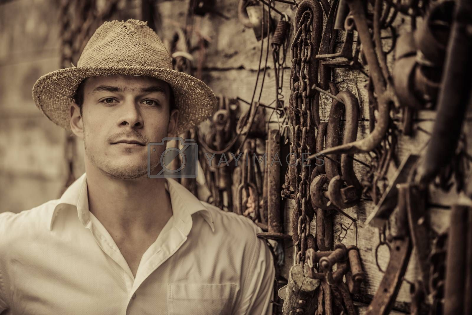 Farmer Portrait in front of a Wall Full of Tools by aetb