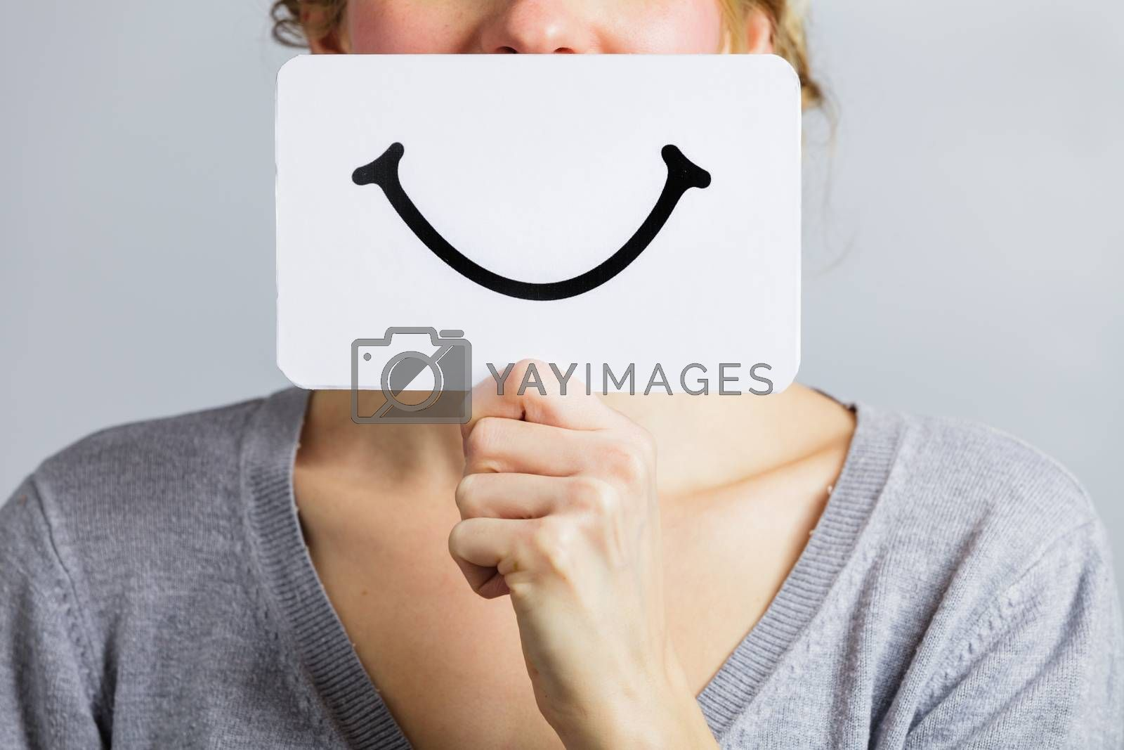 Happy Closeup of a Woman Holding a Smiling Mood Board