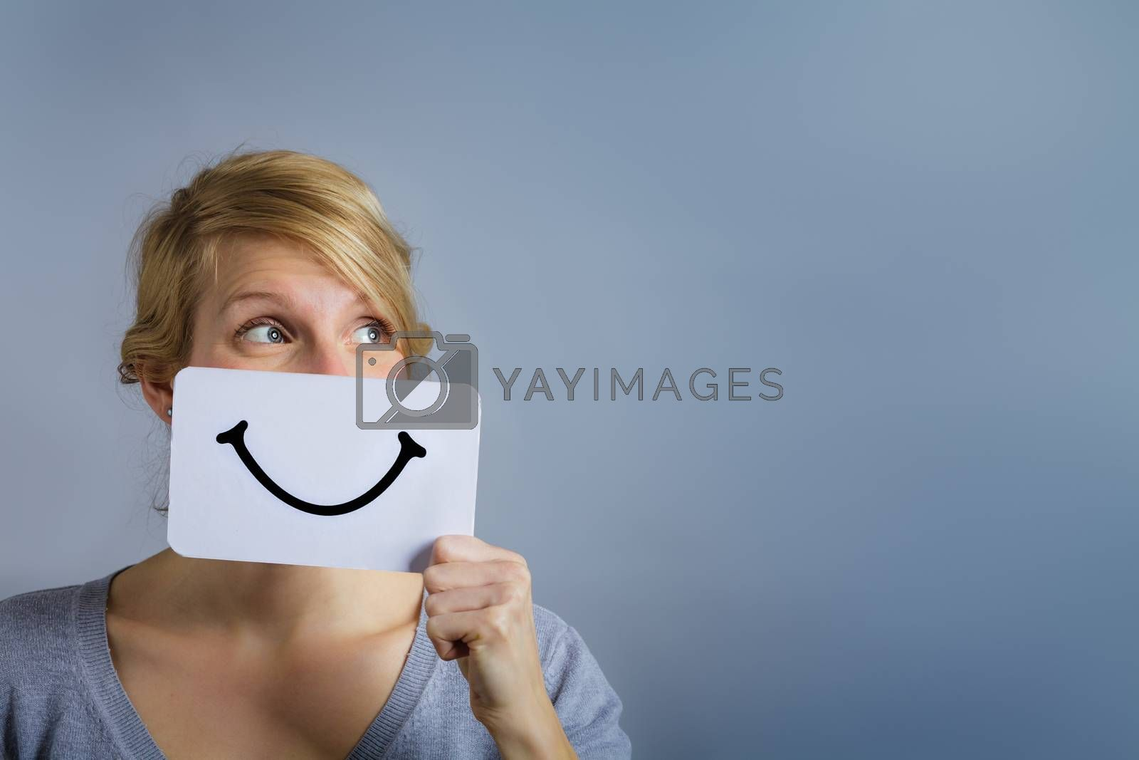 Happy Portrait of a Woman Holding a Smiling Mood Board