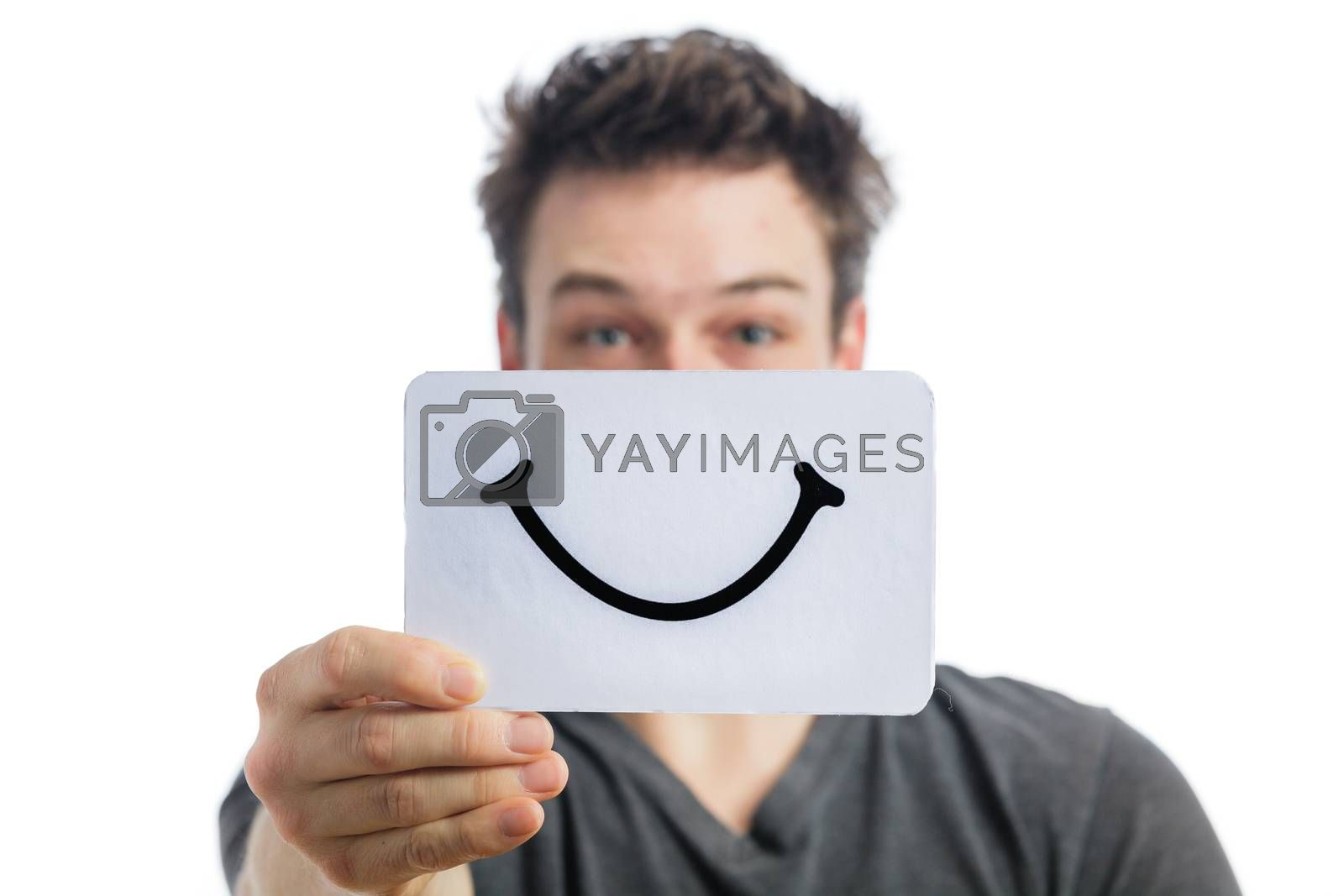 Happy Portrait of a Man Holding a Smiling Mood Board Isolated on White Background