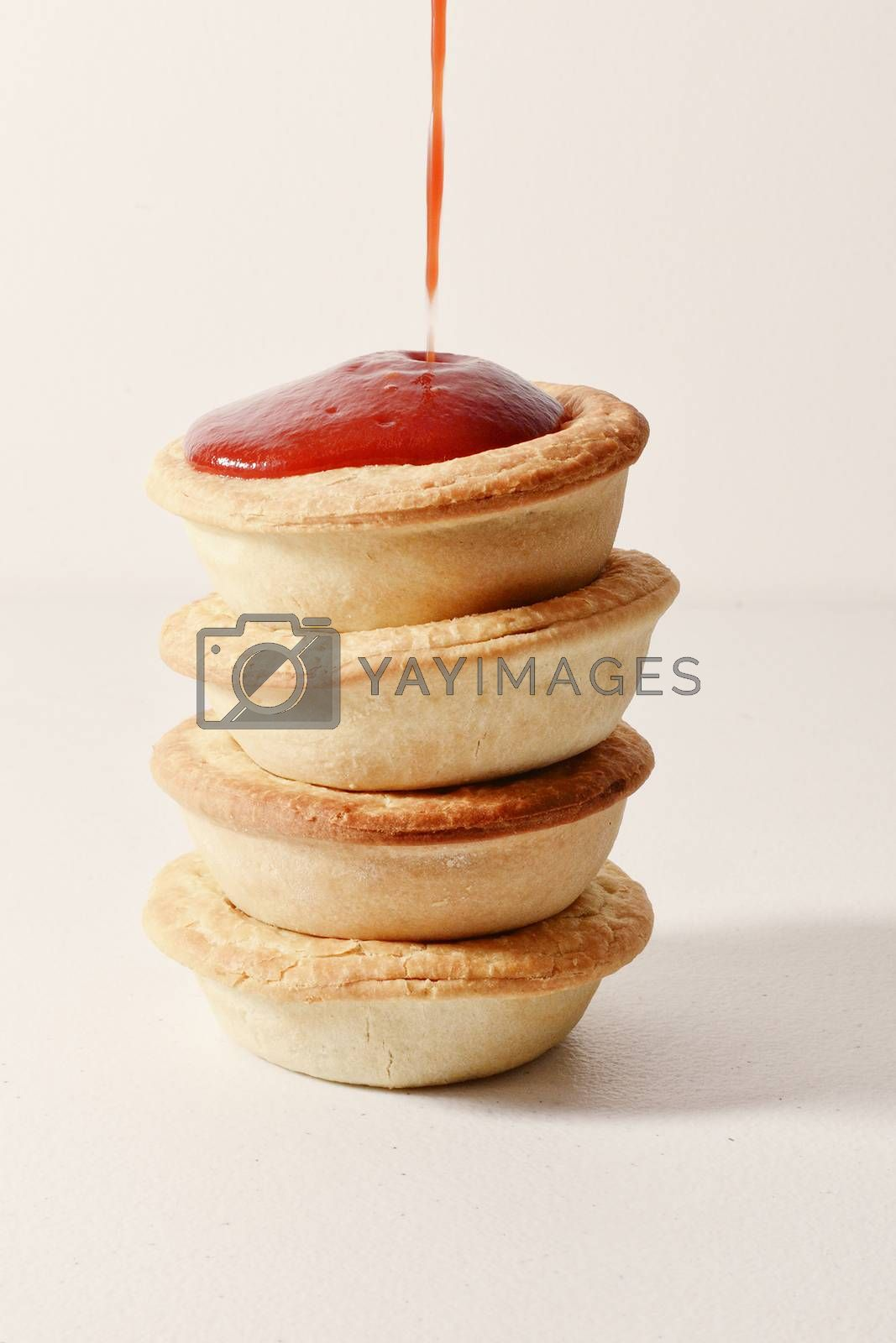Stack of meat pies freshly baked.