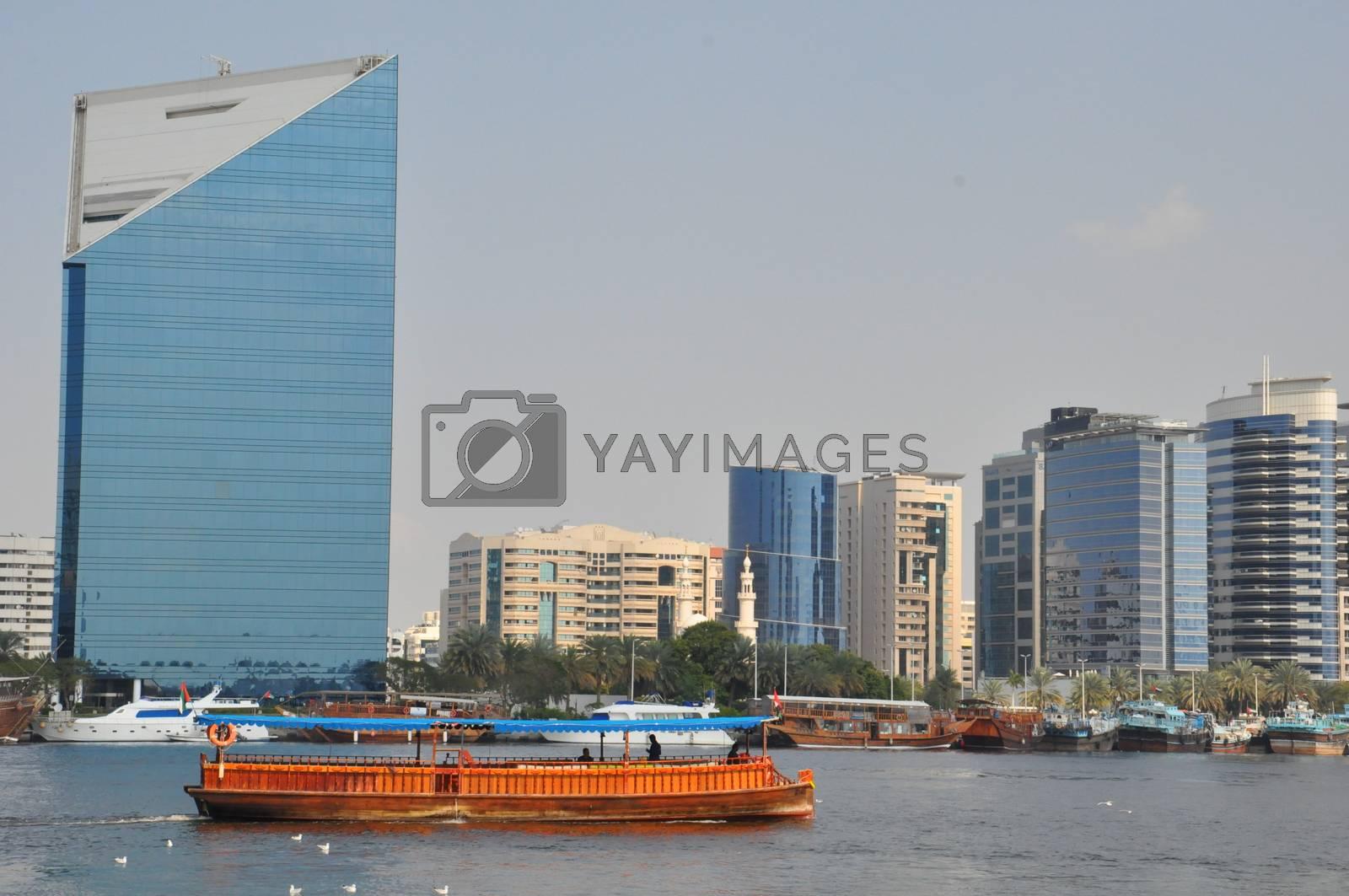 Dubai Creek in Dubai, UAE. The notable buildings along the Deira Creek are Deira Twin Towers, Dubai Creek Tower, National Bank, and Chamber of Commerce.