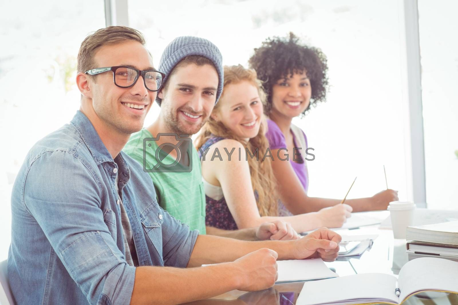 Fashion students smiling at camera at the college