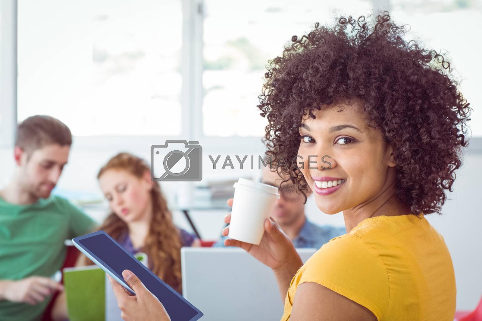 Fashion student smiling at camera by Wavebreakmedia