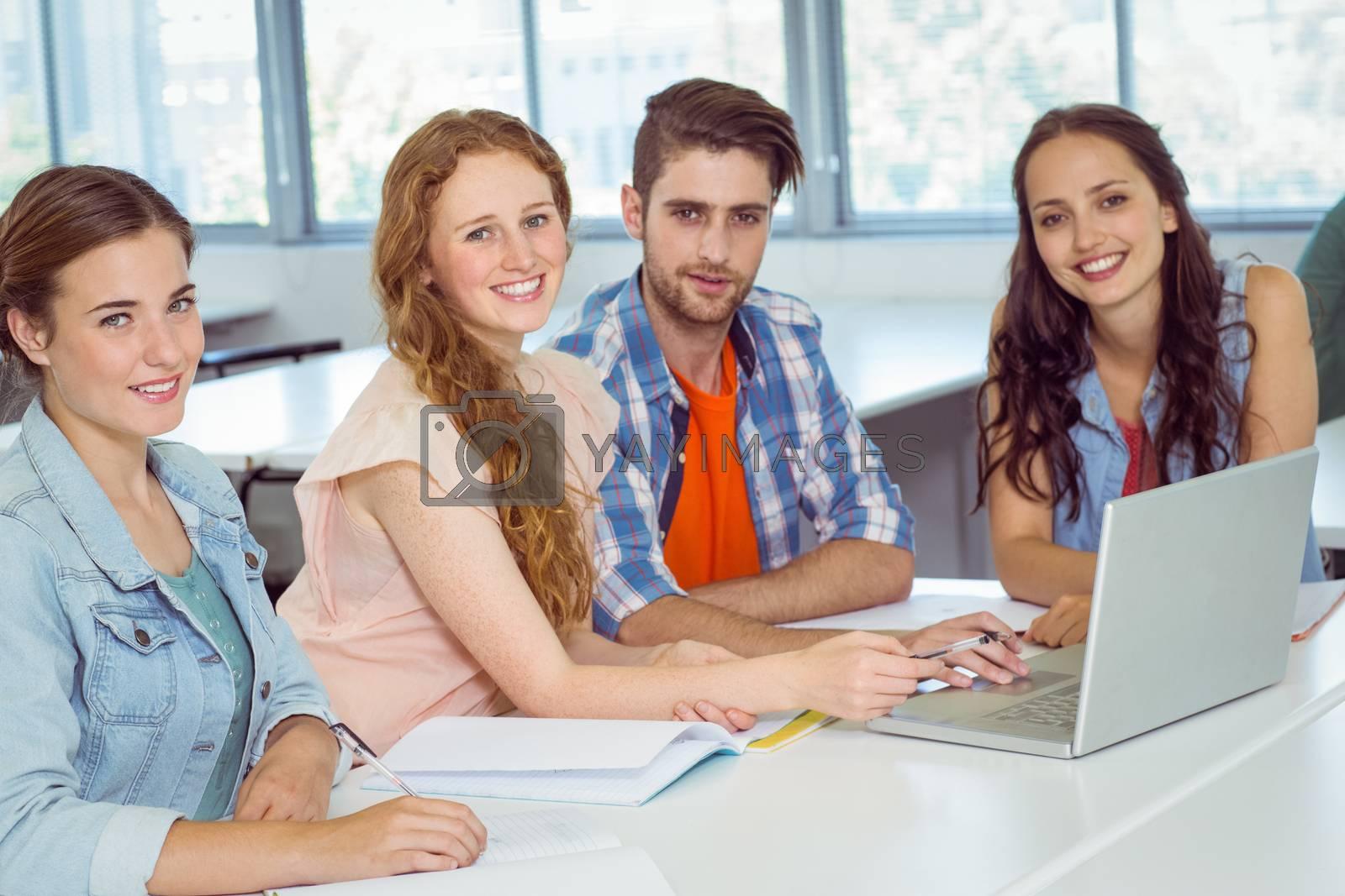 Fashion students looking at camera at college