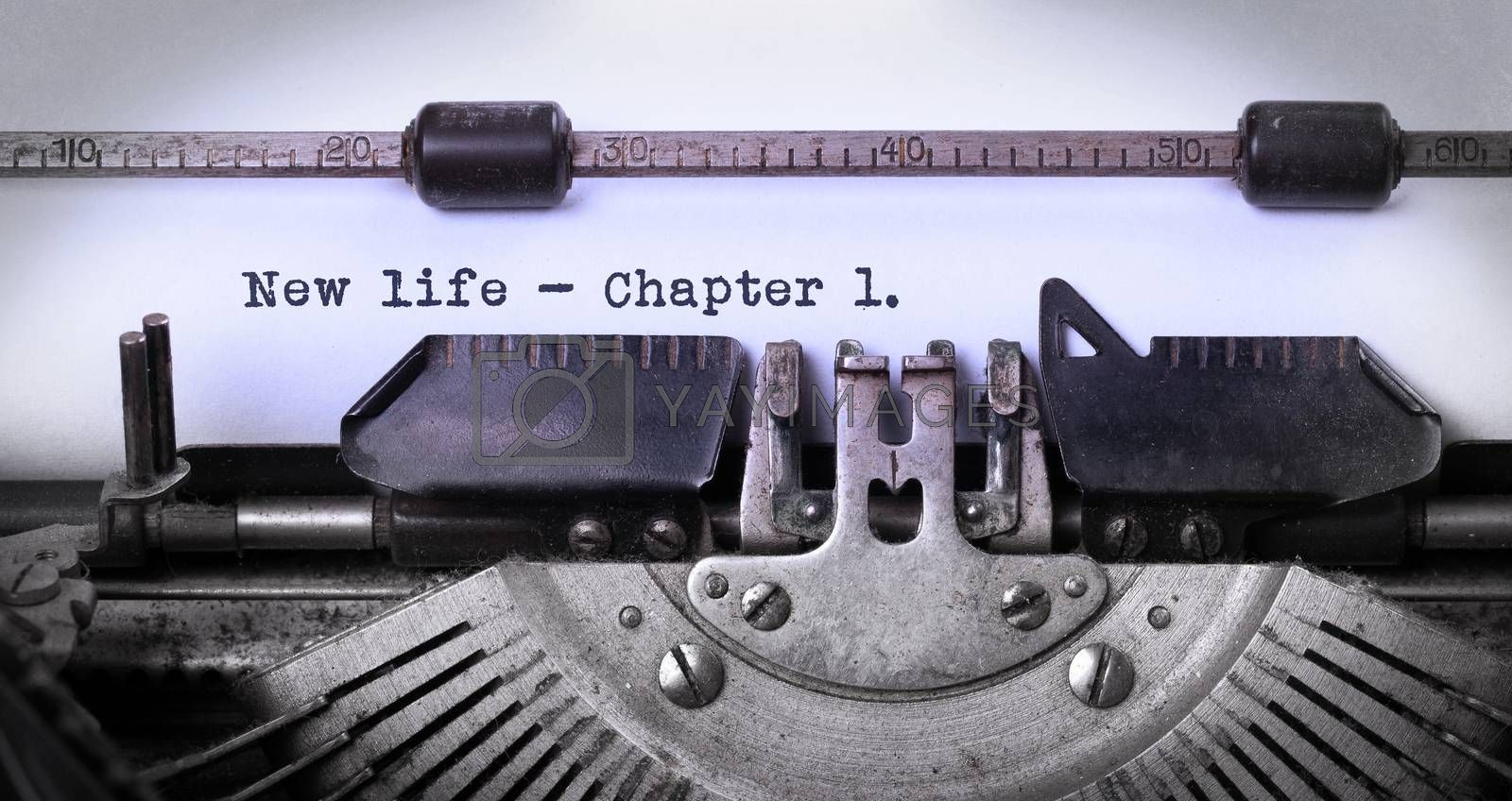 Vintage inscription made by old typewriter, new life, chapter 1