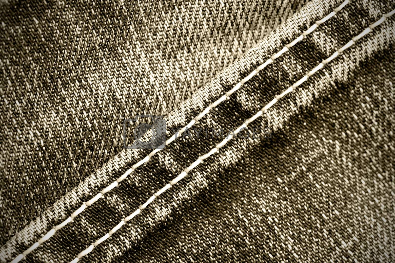 Royalty free image of part of old jeans background with diagonal seams by Astroid