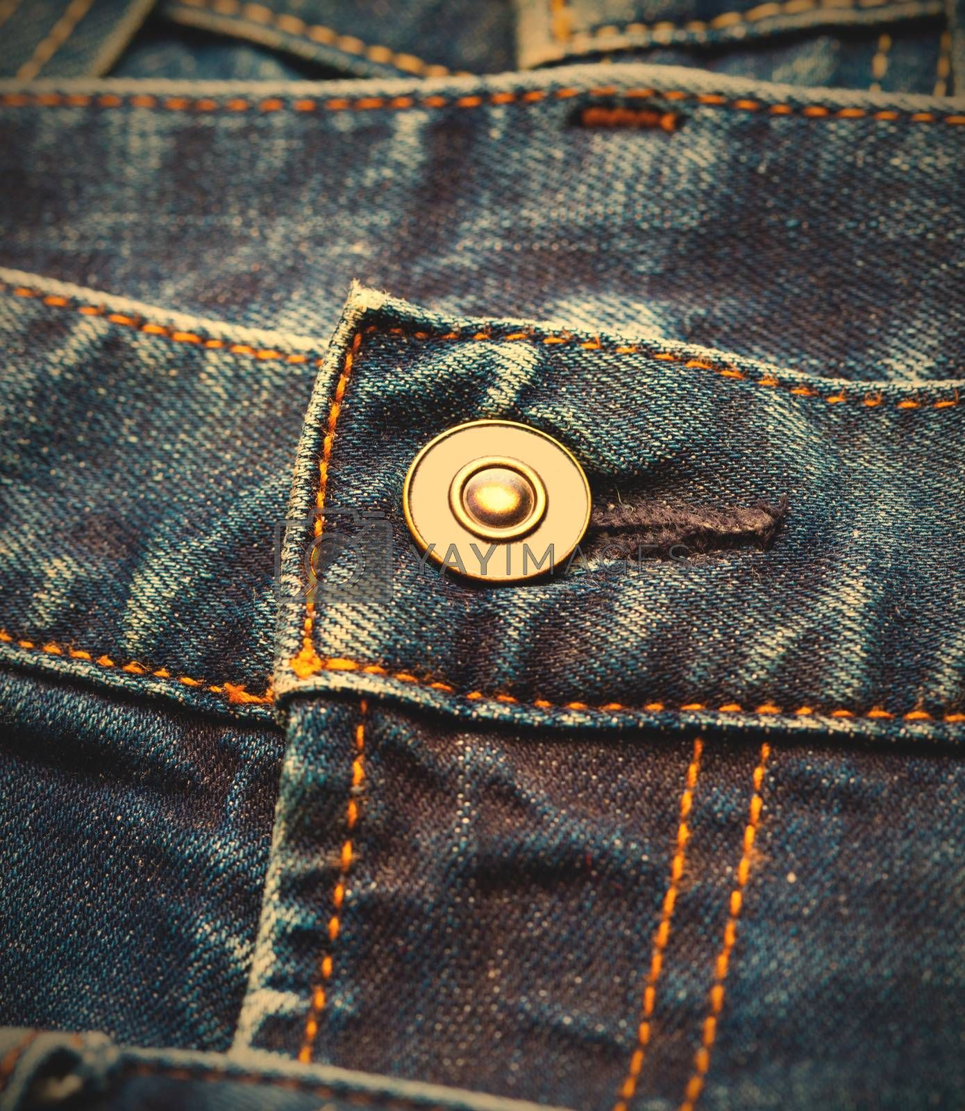 part of blue jeans with button, close up. instagram image retro style