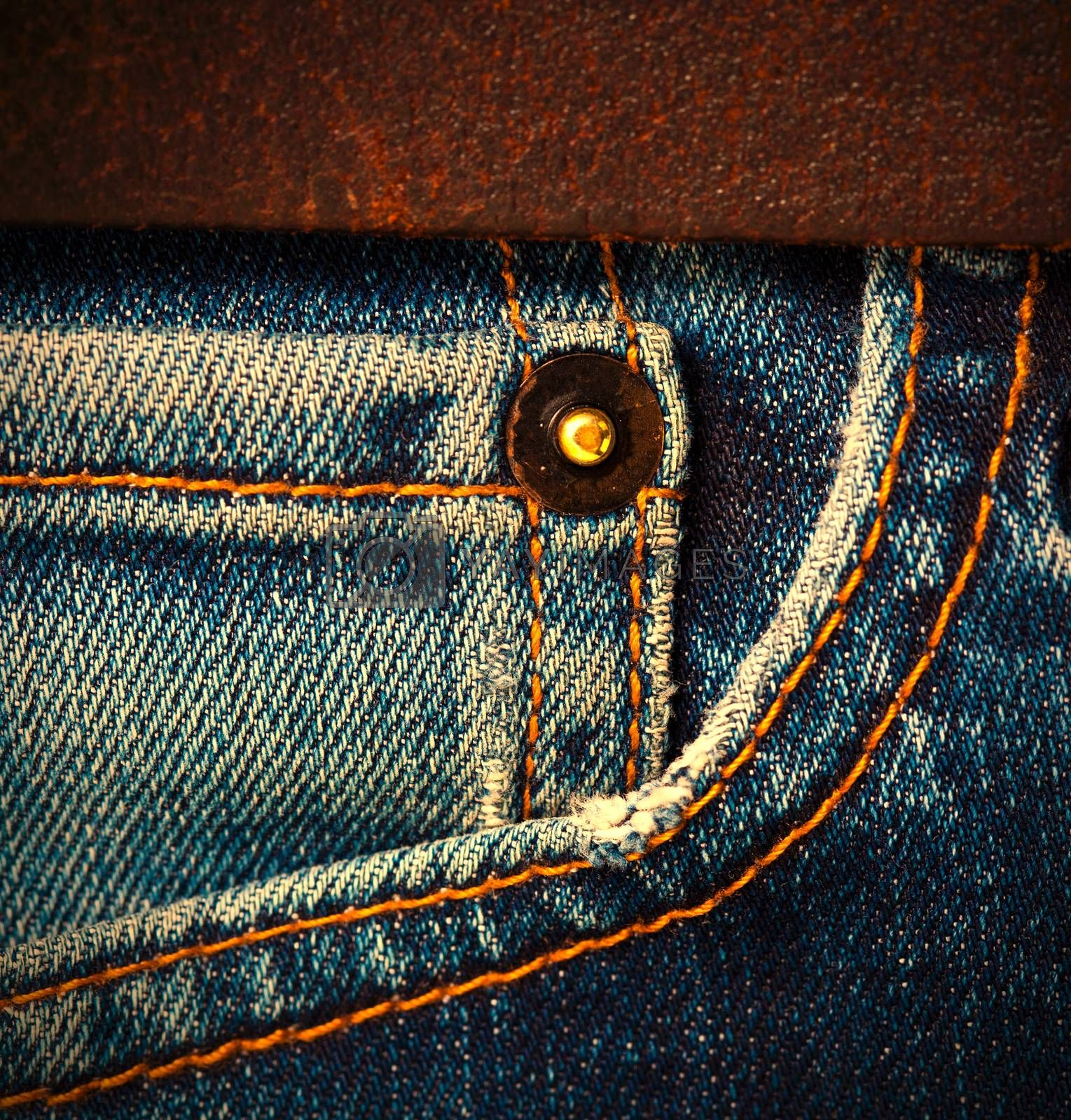 Royalty free image of jeans with a brown leather belt by Astroid