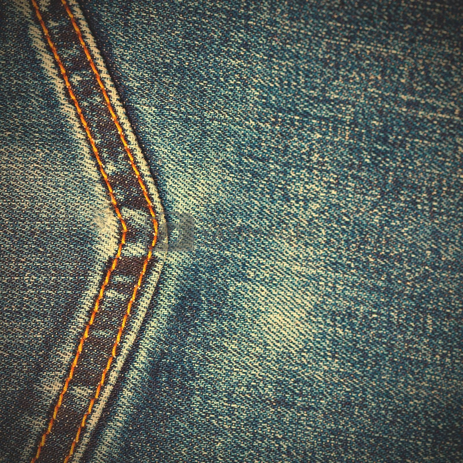 Royalty free image of jeans background with seam by Astroid