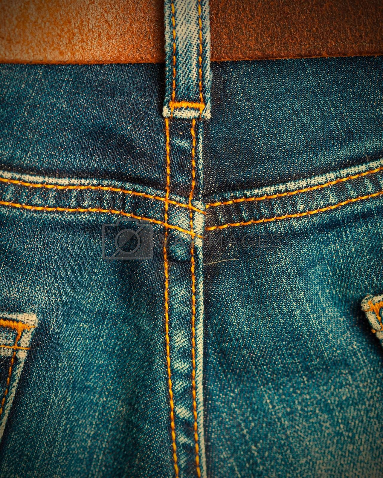 Royalty free image of ol blue denim with seams and leather belt  by Astroid