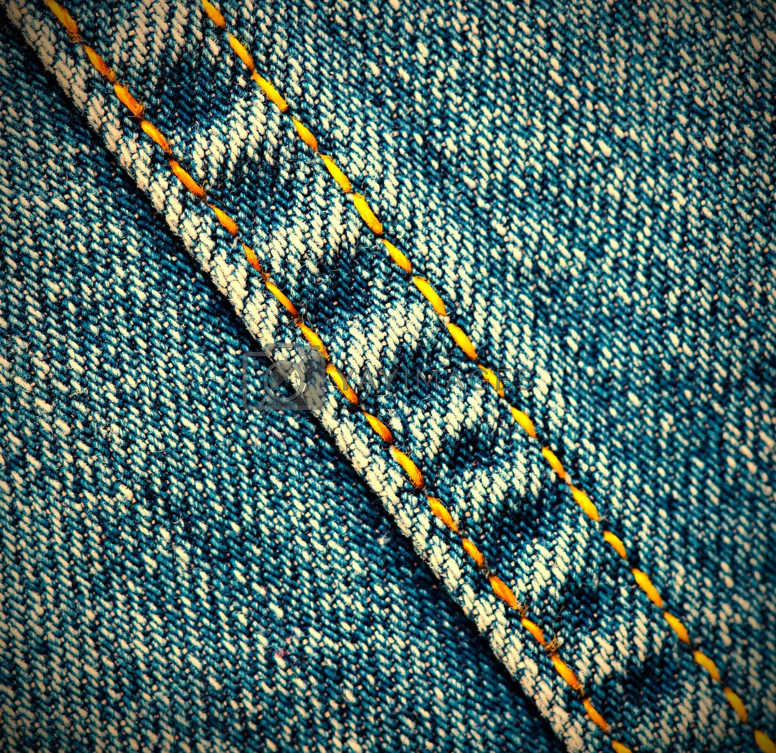 Royalty free image of old jeans background by Astroid