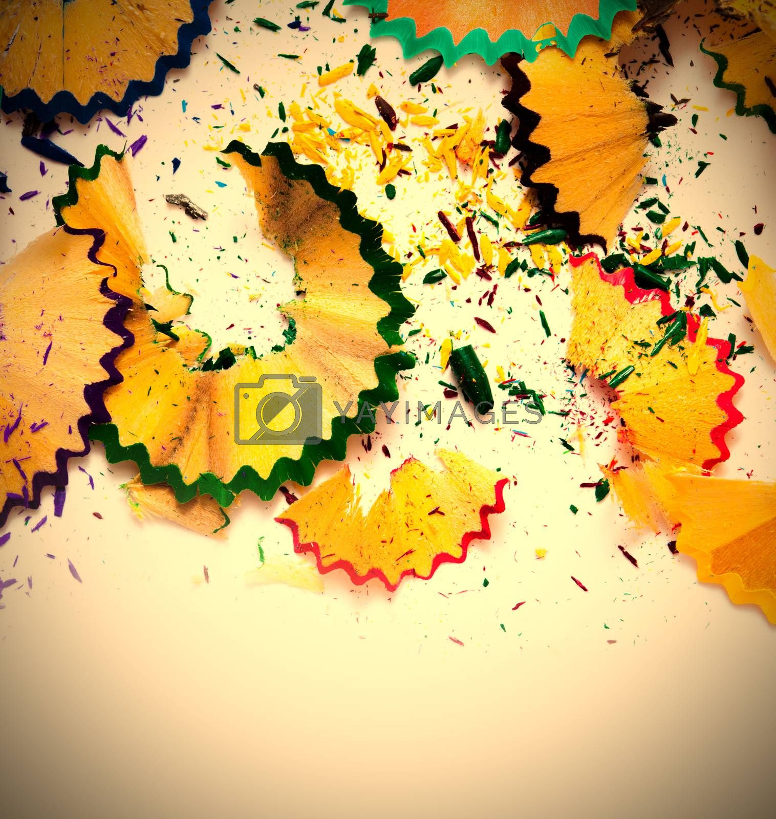 colored pencil shavings on white background with copy space. instagram image retro style
