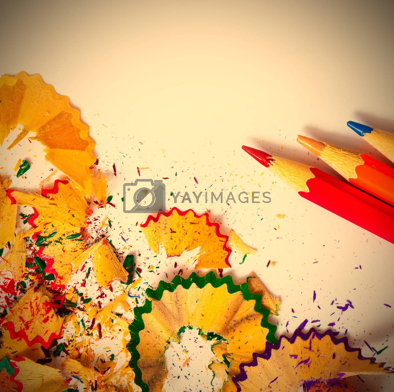 set of colored pencils and shavings on white background with copy space. instagram image style