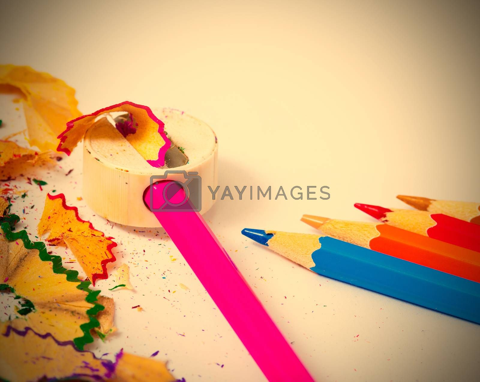 Royalty free image of set of colored pencils, sharpener and shavings  by Astroid