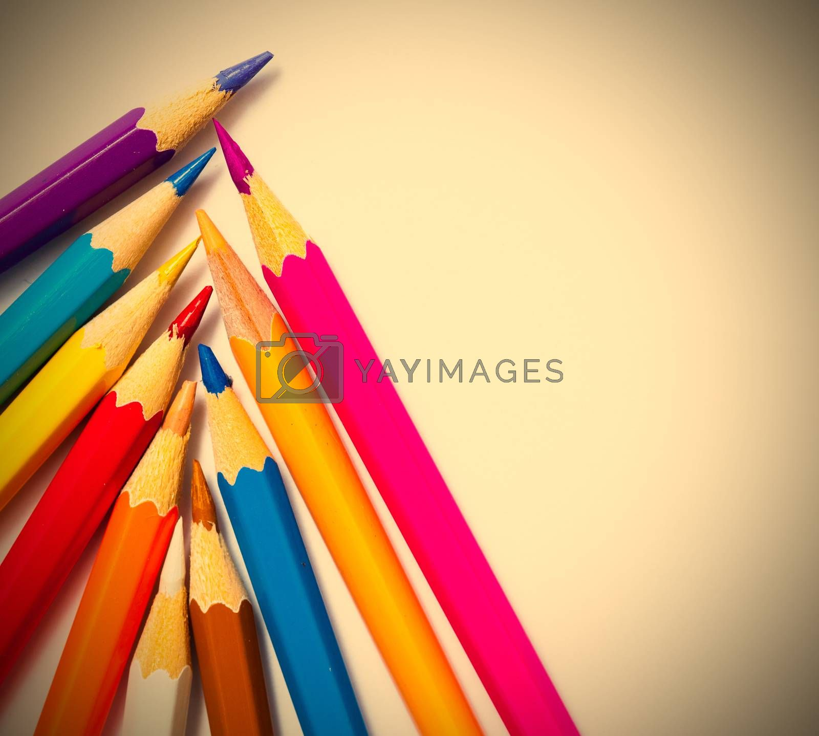 set of colored pencils for drawing on a white background. instagram image retro style