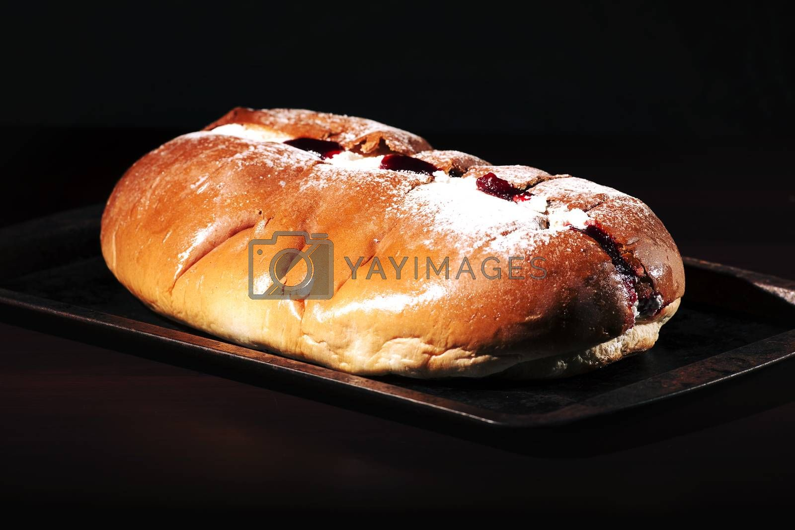 Raspberry jam and cream pastry on a baking tray