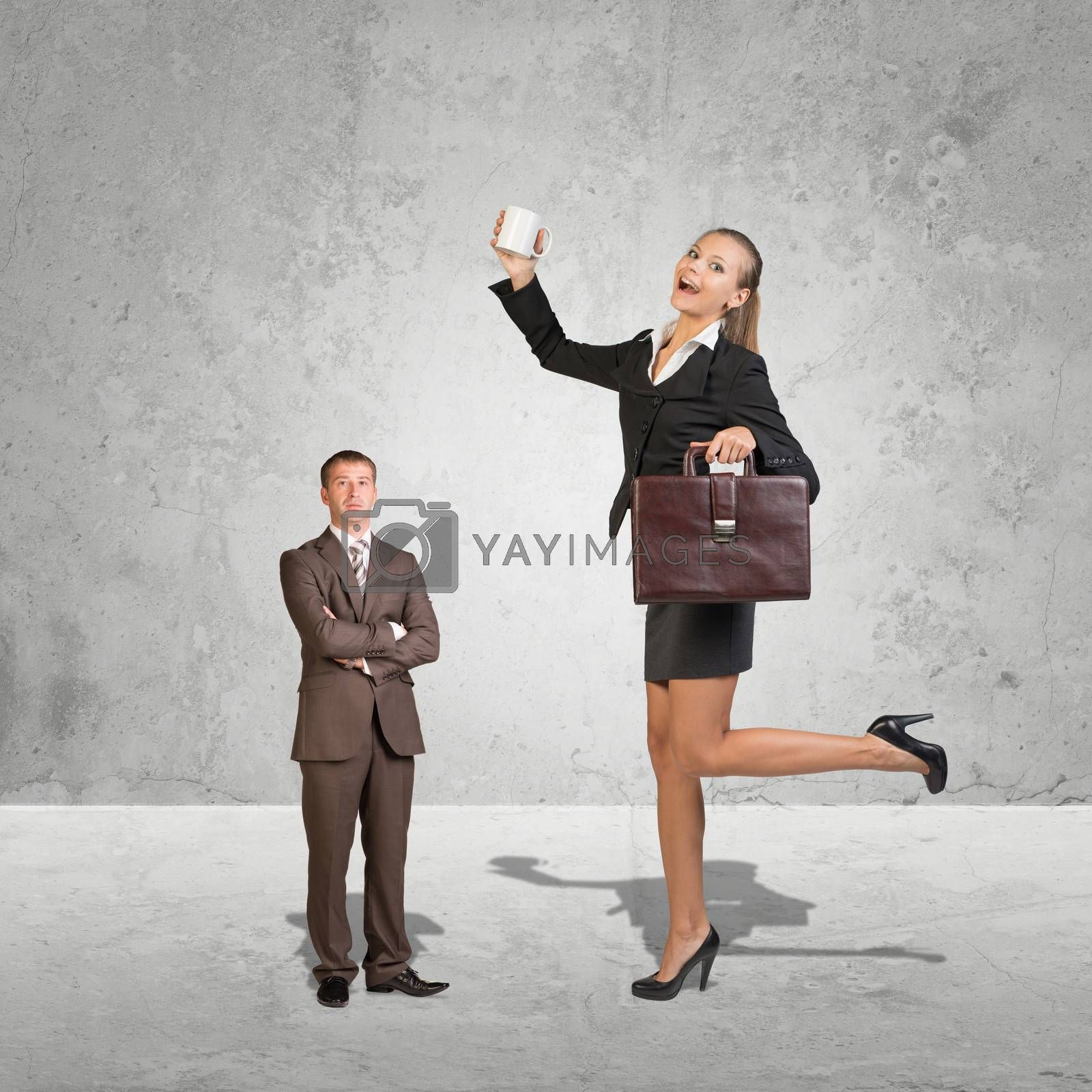 Lagre Young Businesswoman and small Businessman. Concrete background