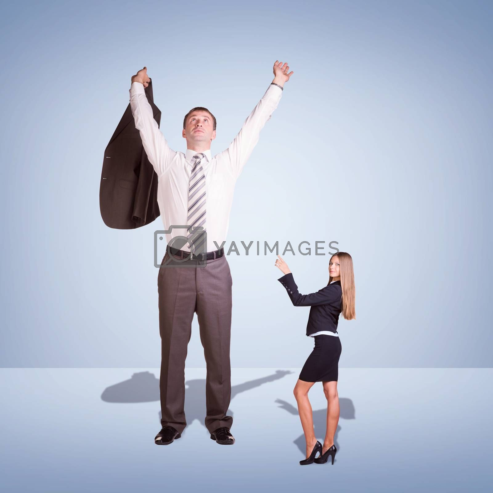 Small Young Businesswoman and Large Businessman. Blue background