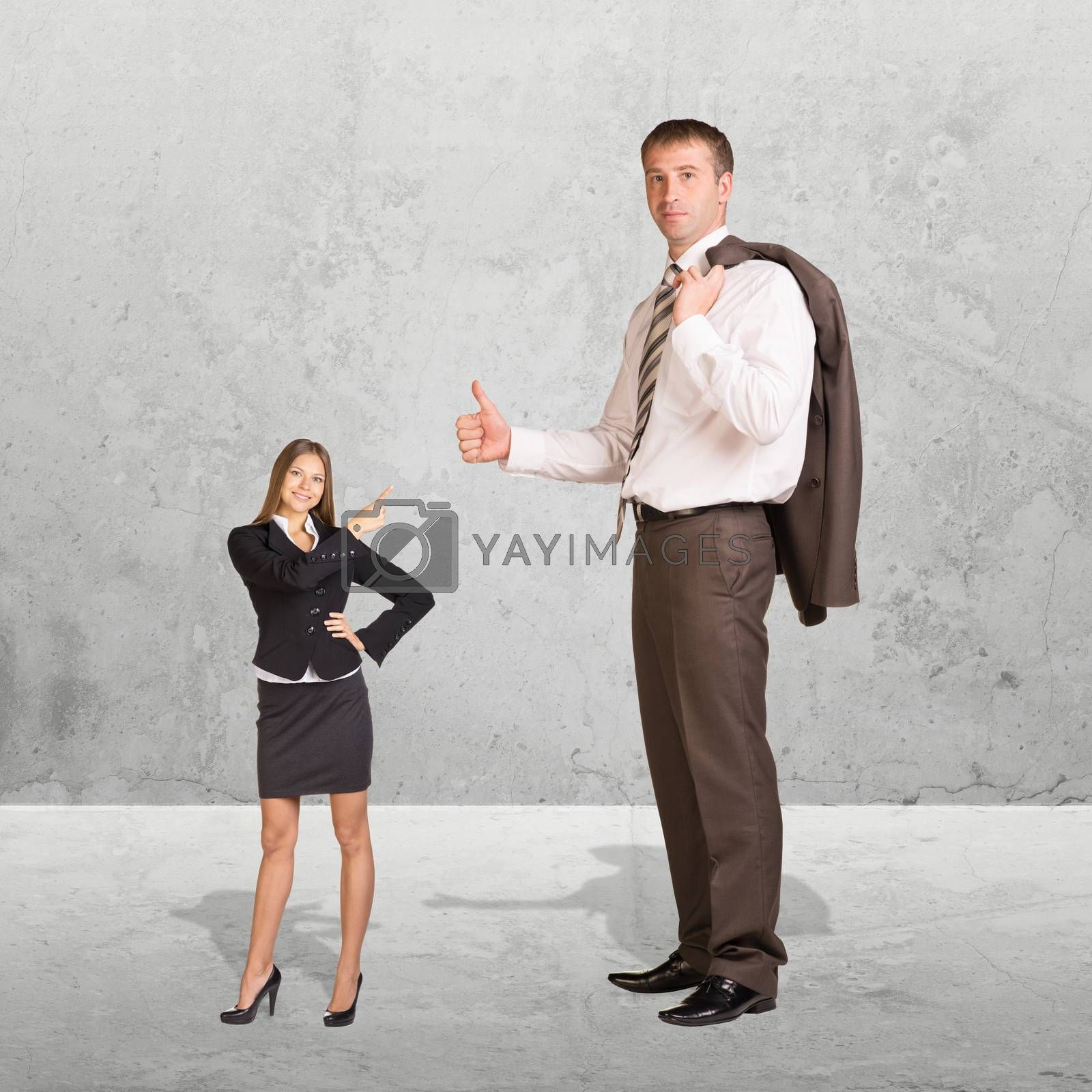 Small Young Businesswoman and Large Businessman. Concrete background