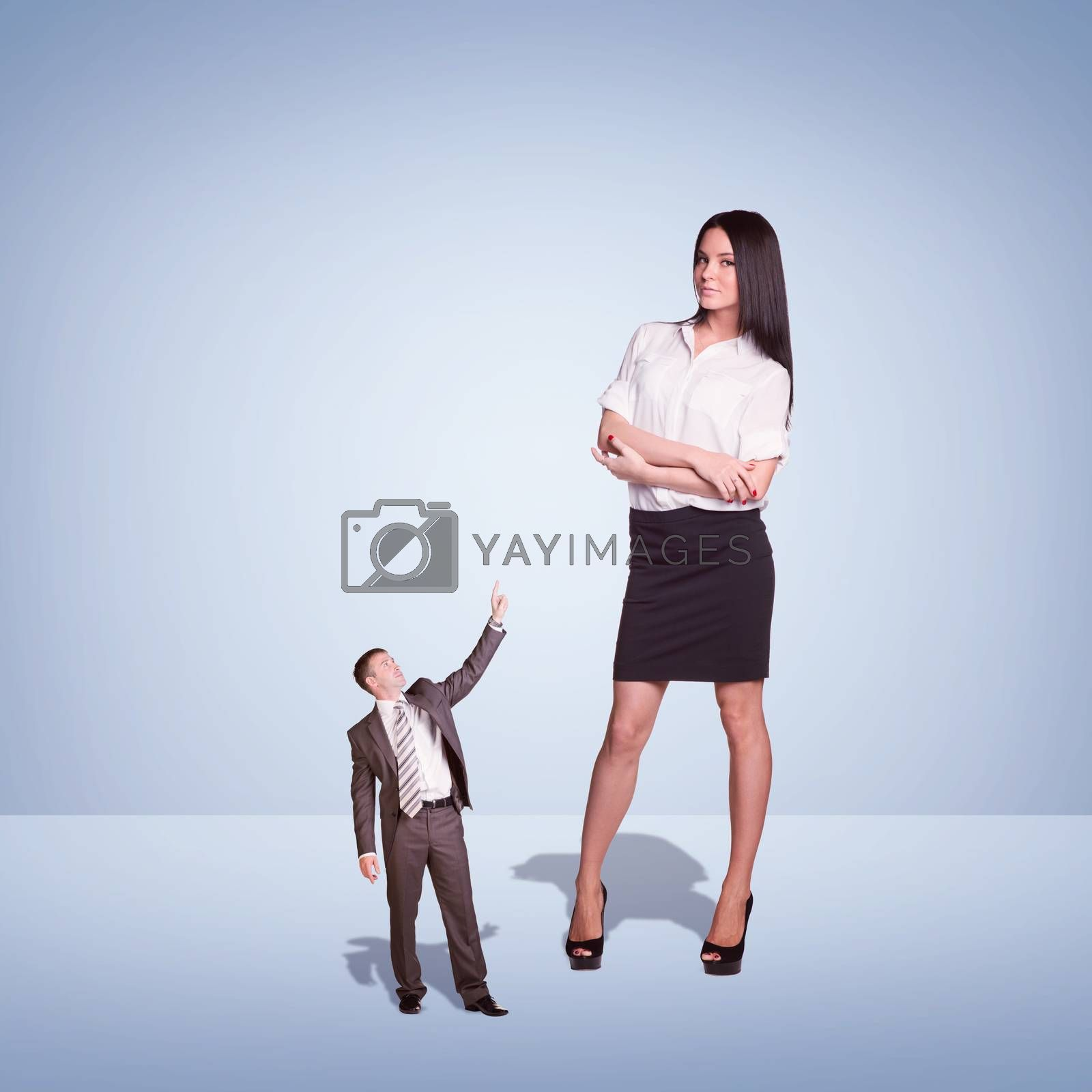 Lagre Young Businesswoman and small Businessman. Blue background
