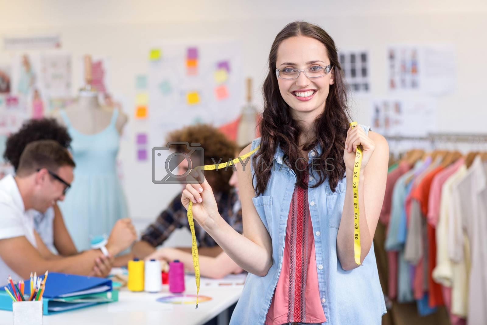 Portrait of confident female fashion designer