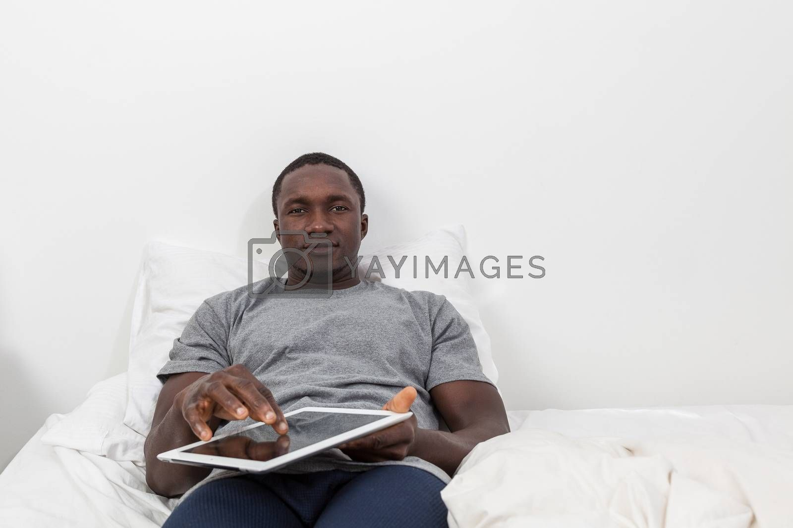 Man touching the screen of his tablet