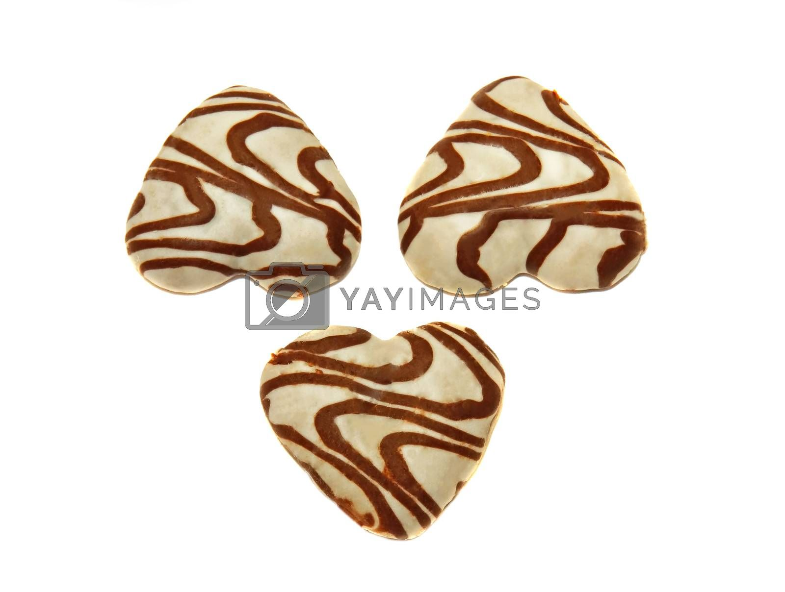 Three cookies, covered with whThree heart-shaped cookies covered by Chiffanna