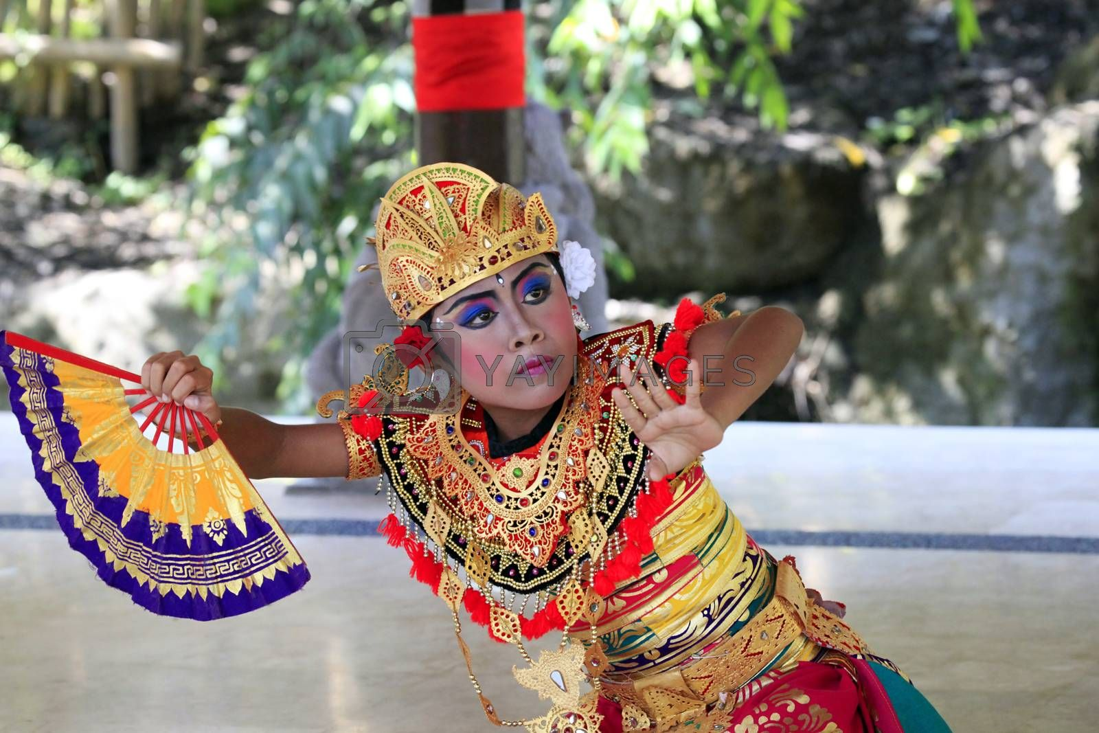 Bali, Indonesia - July 04, 2010: Portrait of dancing boy, ages 10 years old, in national clothes. Traditional daily representation in safari - park to Bali 4 July 2010, Indonesia