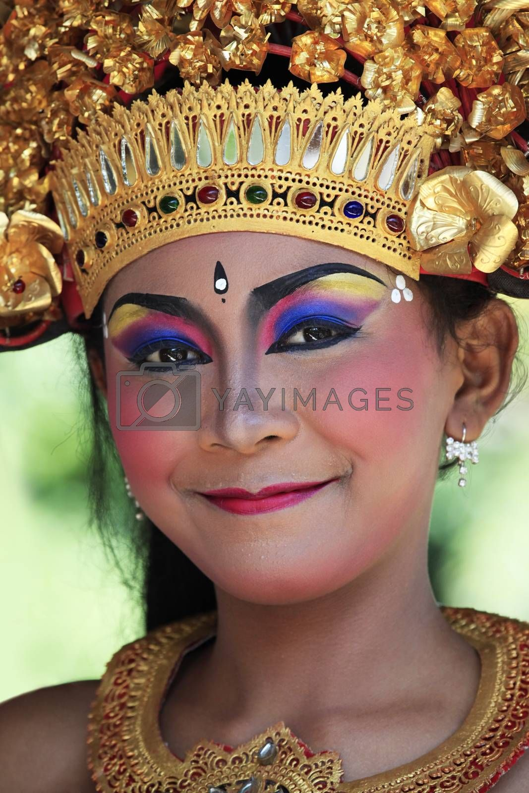 Bali, Indonesia - Jule 04, 2010: Portrait of the young smiling girl in national clothes to Bali 4 Jule, 2010. Indonesia