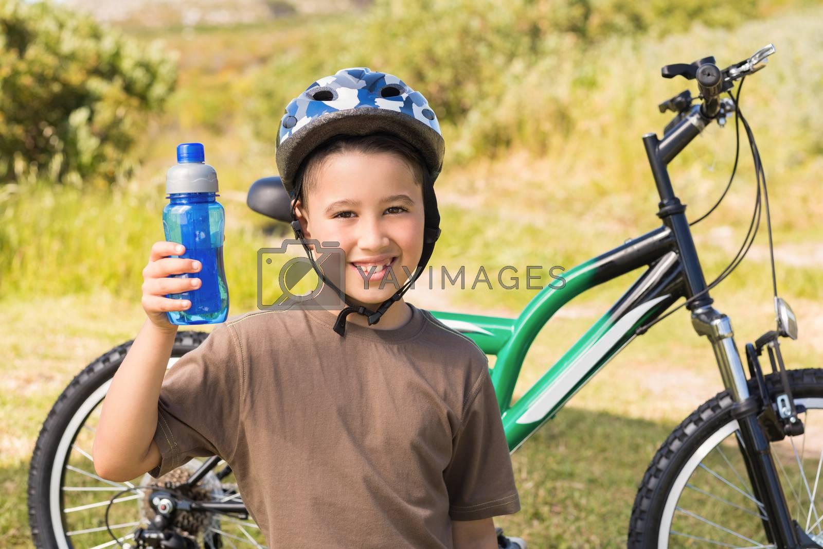 Little boy on a bike ride by Wavebreakmedia