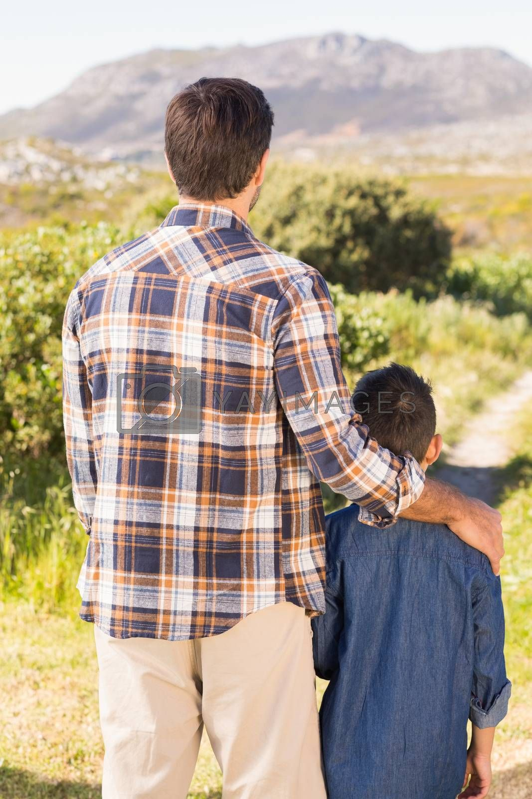 Father and son on a hike together by Wavebreakmedia