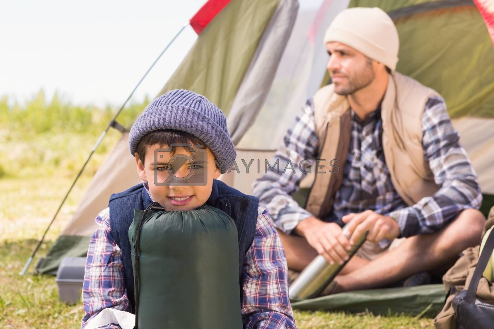 Father and son in their tent by Wavebreakmedia