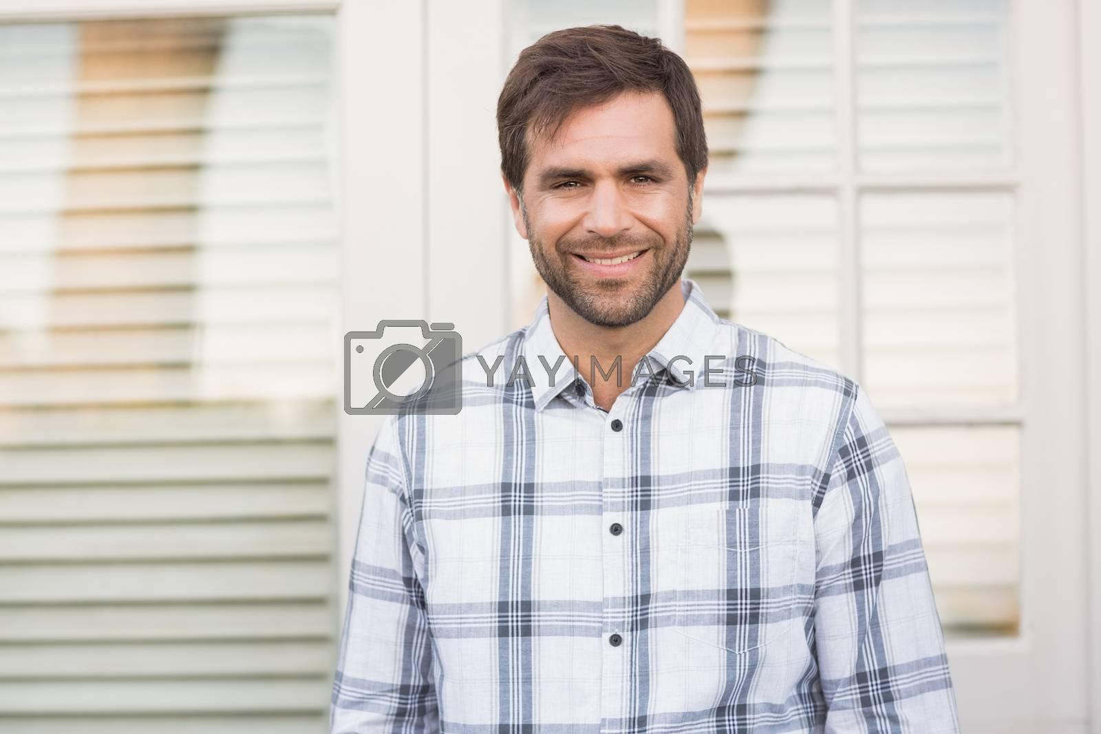 Happy man smiling at camera by Wavebreakmedia