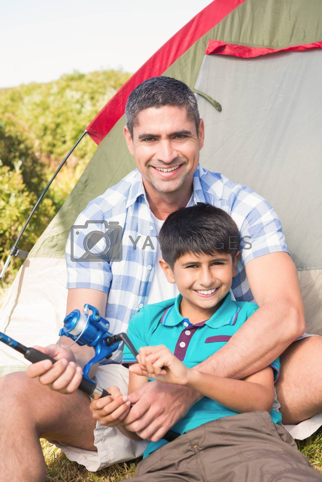 Father and son beside tent by Wavebreakmedia