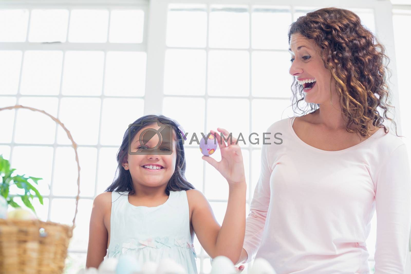 Royalty free image of Happy girl holding easter egg  by Wavebreakmedia